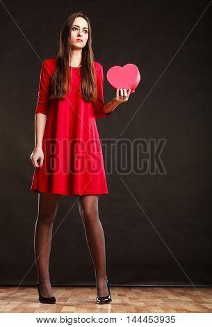 Woman Holding Heart Shaped Gift Box