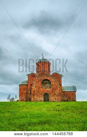 Architecture summer landscape in cloudy weather - Church of the Transfiguration of Savior on Kovalevo in Veliky Novgorod Russia.