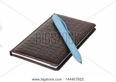 Brown leather notebook with blue pen isolated on white background