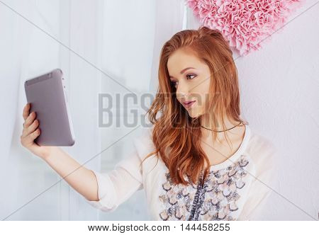 young girl with the tablet. The concept of lifestyle
