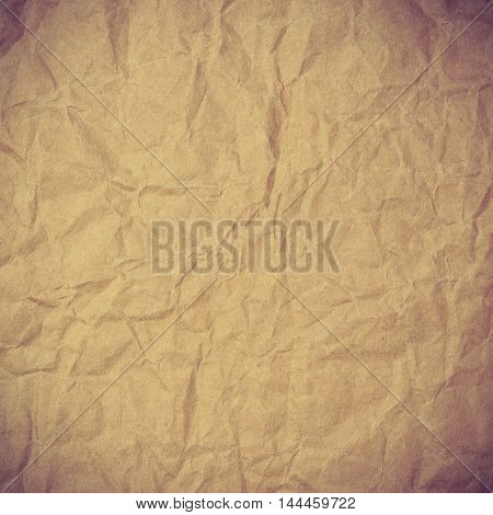 Old vintage crumpled brown page paper texture or background