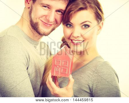 Couple Showing Affection With Home Symbol