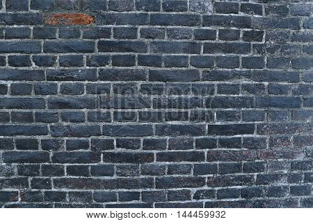 Texture of a black burnt sooty brick wall