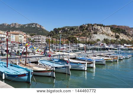 Row of traditional boats inside the harbor of Cassis France