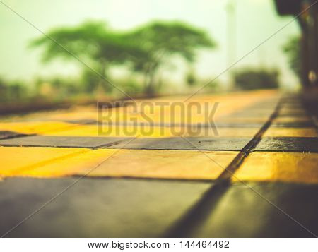 abstract waiting train station yellow and black color