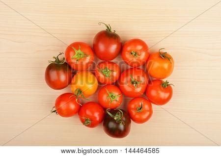 Tomato On Wooden Background