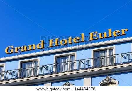 Basel, Switzerland - 27 August, 2016: upper part of the Grand Hotel Euler building. Euler Hotel Basel is a newly refurbished 4-star hotel boasting first-class traditional hotel culture for over 140 years, located right at the Basel train station.