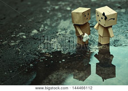 Romance after the rain. Danbo is an action figure that have many expresion on it face.