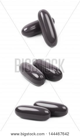 Black medical drug pill isolated over the white background, set of three different foreshortenings