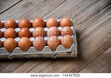 tray of Eggs on a wood background