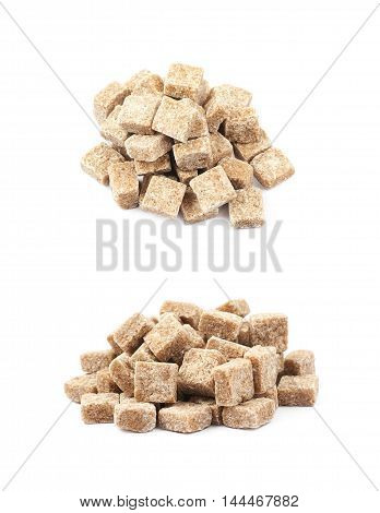 Pile of brown sugar cubes isolated over the white background, set of two different foreshortenings