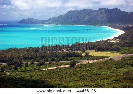 The 3 mile stretch of pristine beach at Waimanalo Bay with  incredible backdrop view of the steep Koolau Mountains Oahu, Hawaii