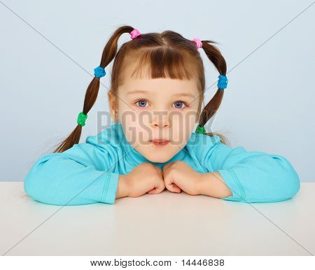 Little Girl Sitting At Desk