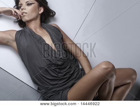 fashion shoot of sexy lady over glass background