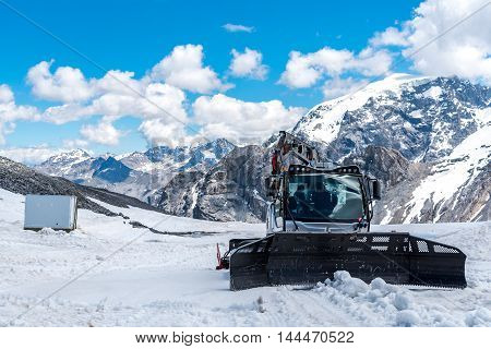 Large view on the snowplows in the high Alps Austria