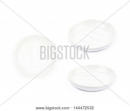 White ceramic empty soap plate isolated over the white background, set of three different foreshortenings
