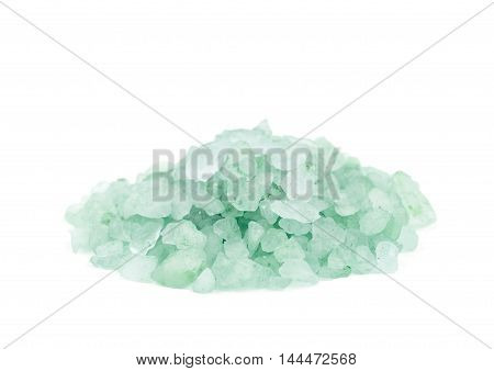 Pile of salt crystals isolated over the white background