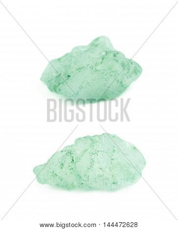 Single crystal of salt isolated over the white background, macro close-up shot with the shallow depth of field, set of two different foreshortenings