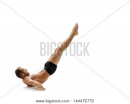 Sport. Gymnast training to keep his body balance, isolated on white