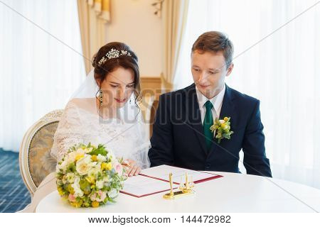 Young happy bride and groom on their wedding. Marriage concept