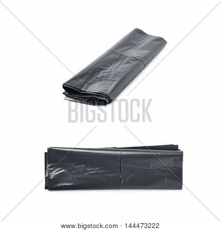 Single black plastic polyethylene trash bag folded and isolated over the white background, set of two different foreshortenings