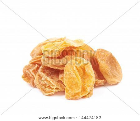 Pile of dried apricot fruits isolated over the white background