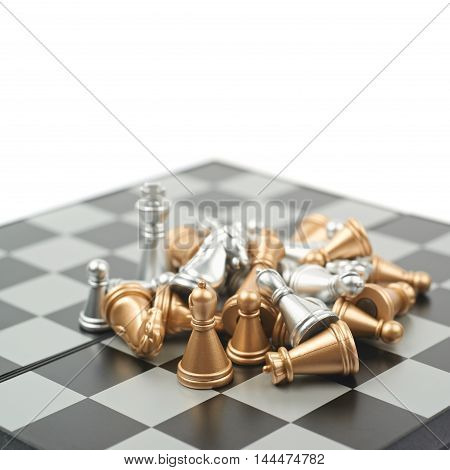 Pile of chess figures on a board, composition isolated over the white background