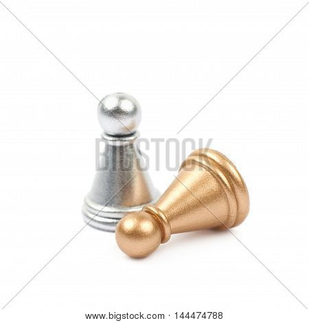 Two chess pawns, silver and golden, isolated over the white background