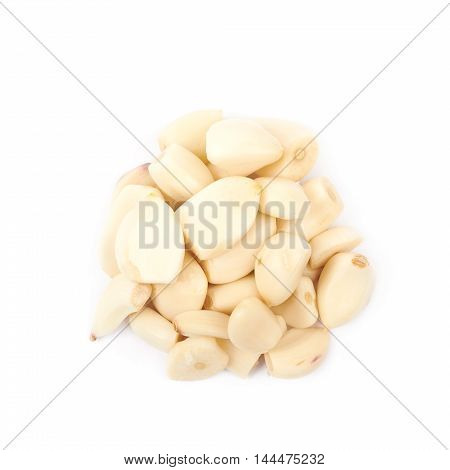 Pile of peeled garlic isolated over the white background