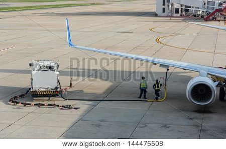 Airport Worker Service Refuelling The Aircraft