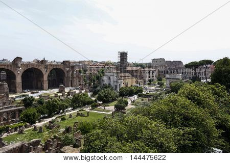 view of forum roman with coliseum in background rome italy