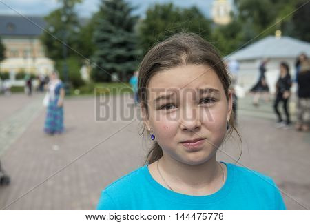 Sad teen girl on the street