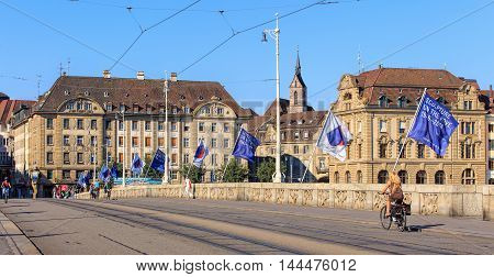 Basel, Switzerland - 27 August, 2016: Mittlere Bruecke bridge over the Rhine river. Basel is a city in Switzerland located where the borders of France, Germany and Switzerland meet.