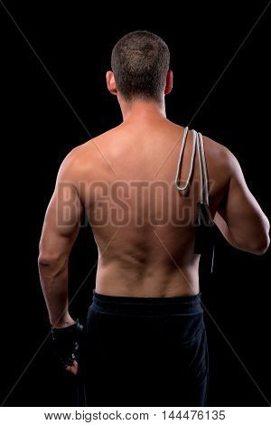 Naked Back Athlete With A Skipping Rope Isolated On A Black Background