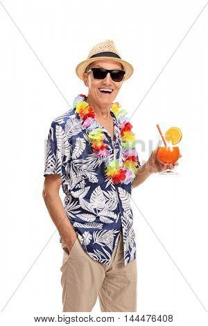 Happy senior tourist holding a cocktail isolated on white background