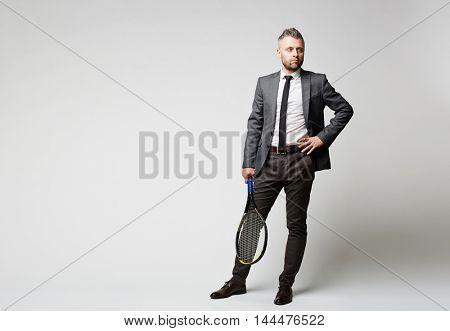 Businessman with tennis racket