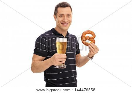 Happy man holding a pretzel and a pint of beer isolated on white background