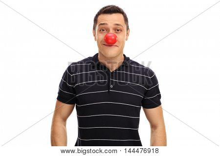 Young guy posing with a red clown nose isolated on white background