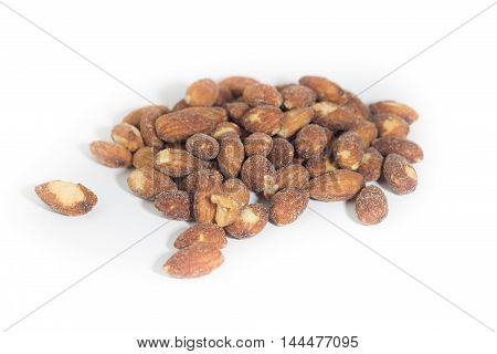 Roasted almonds isolated. Salted and roasted almonds on white background