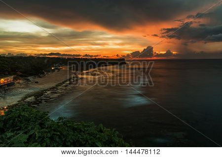 Sunset at Balangan beach, Nusa Dua, is one of the most beautiful in Bali, it is called Mars at its bottom is covered with volcanic rock. beautiful coastline