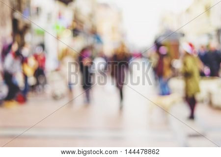 abstract blurred background of people walking in city center