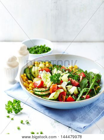 Colorful Vegetable Salad with Herbs in a Bowl