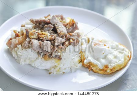 Rice with fried pork with garlic and pepper