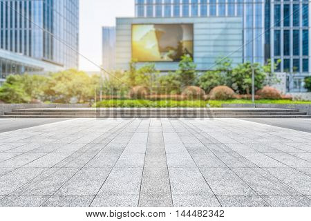 empty pavement front of modern office buildings