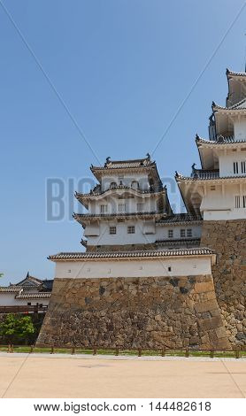HIMEJI JAPAN - JULY 21 2016: West small keep (kotenshu) of Himeji castle (circa 1609) after repairing works ended 2015. National Treasure of Japan and UNESCO World Heritage Site