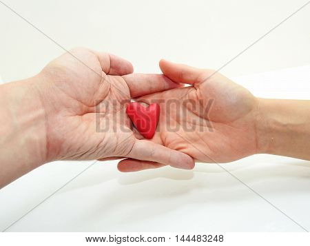 Man's And Woman Hands With Red Heart