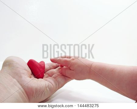 Man's And Child Hands With Red Heart
