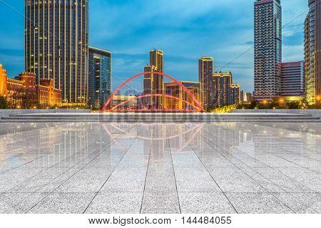 empty brick floor with city skyline background