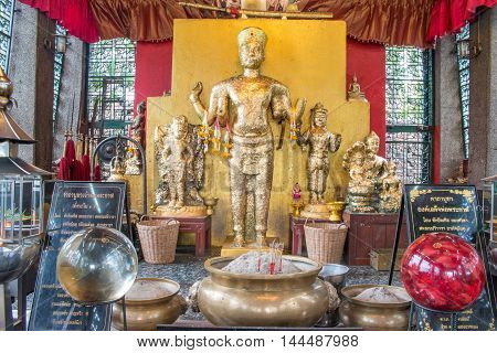 Old golden Buddha Statue (Bayon Style) with gold leaf.