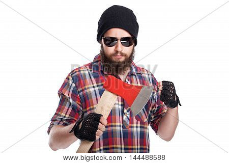 Confident young bearded man holding an axe and looking at camera while standing against white background
